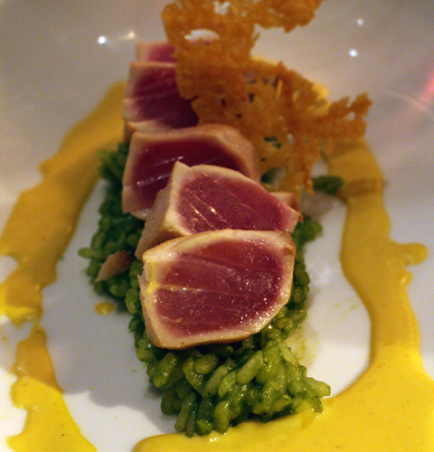Ahi with pesto risotto and aji amarillo sauce.
