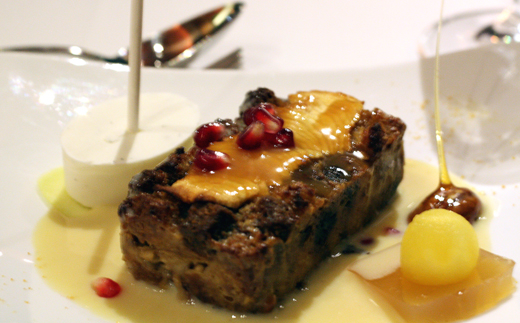 Warm and wonderful bread pudding with a boozy eggnog sauce.