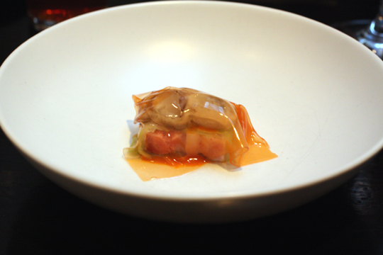 Oyster snuggled with pork belly in a translucent gelatin membrane.