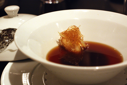 "Faux ""shark fin'' soup with black truffle custard."