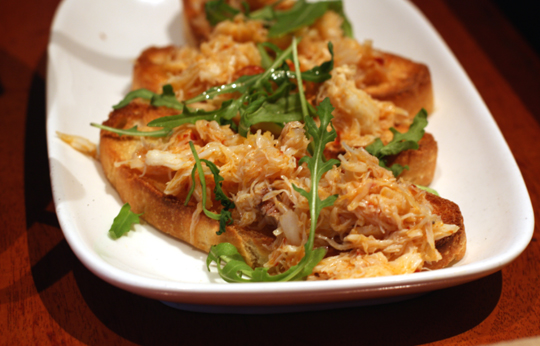 Crostini topped with Dungeness crab.