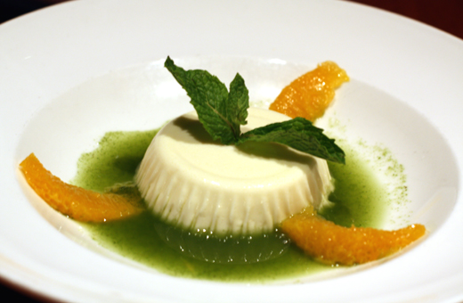 Coconut panna cotta in mint syrup with citrus.