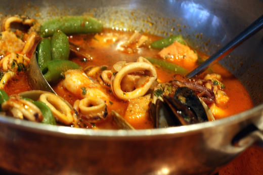 Seafood stew with the questonable addition of sugar snap peas.