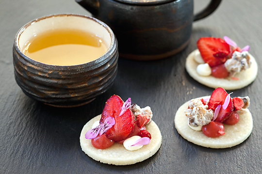 Tea with strawberries on yogurt sables. (Photo by Justin Lewis)