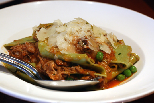 Wide, tender noodles covered in rich lamb ragu.