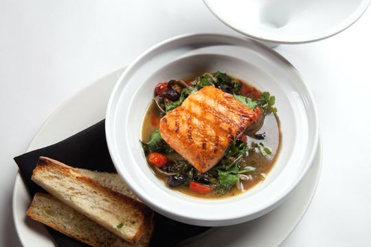 Grilled salmon tagine with sourdough crostini. (Photo courtesy of Bistro Boudin)