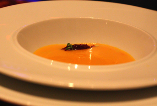 Smooth, silky carrot soup with a garnish of beets.