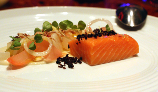 King salmon with young almonds and black olives.