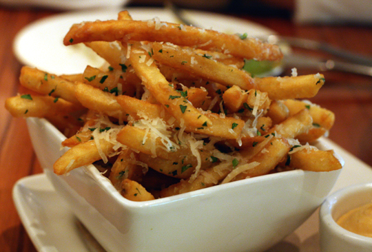 Truffle fries with a flourish of Grana Padano.