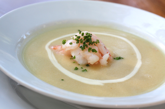 Creme fraiche garnishes a summer corn soup.