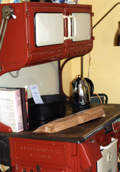 An antique stove decorates the main room of the cottage.