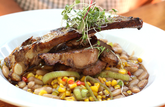 Roast pork with corn and cannellini beans.
