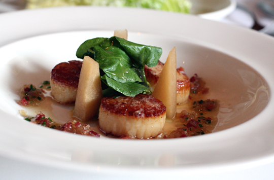 Plump scallops get the bacon treatment. (Photo by Carolyn Jung)
