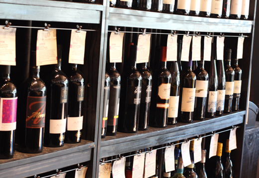 A wall of wines -- to enjoy at the bar or to buy to take home.