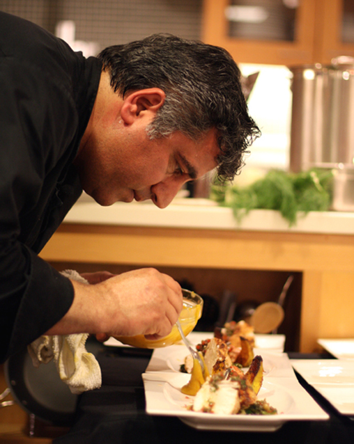 Chef Hoss Zare plating his first dish at the Macy's Union Square cooking challenge.