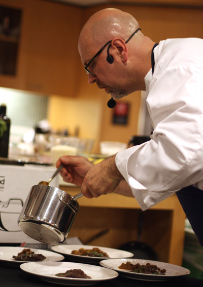 Terje puts the finishing touches on his pasta dish.