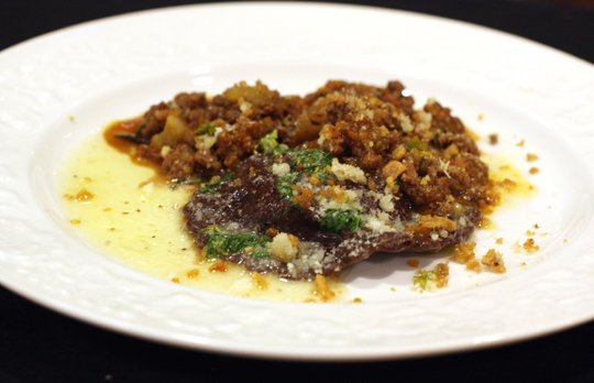 Terje's kabocha-filled cocoa raviolo with lamb sugo.