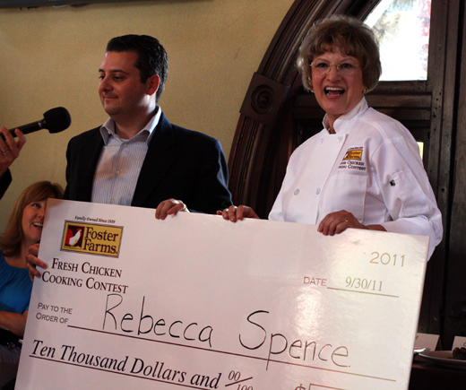 Rebecca Spence receives her grand prize check.
