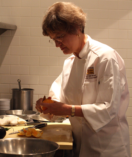 Rebecca Spence of Vancouver, WA preps navel oranges for her dish.