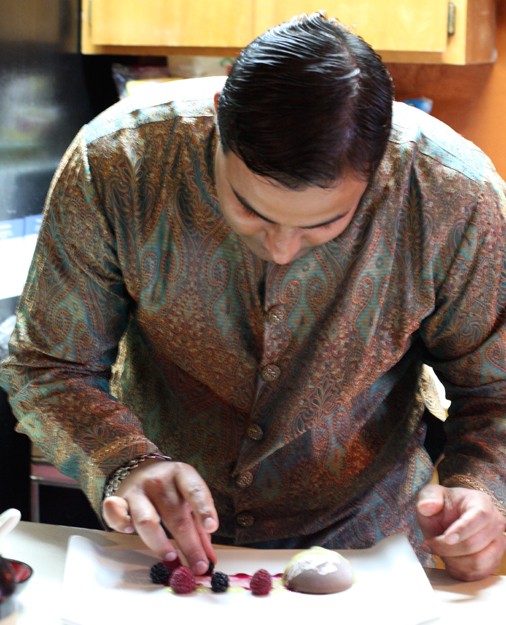 Chef Sachin Chopra, all dressed up for the holiday, puts the finishing touches on a dessert for Diwali.