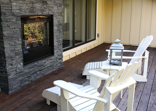 The room's double-sided fireplace can be enjoyed from the deck, too.