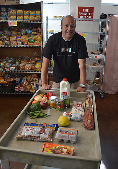Exec. Pastry Chef Carlos Sanchez of Parcel 104 picks his ingredients from the food pantry. (Photo courtesy of West Valley Community Services)