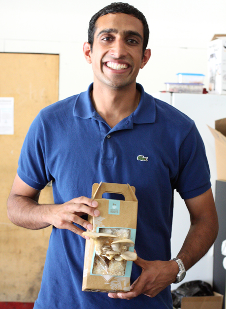 Nikil Arora proudly shows off the oyster mushroom kit he helped develop