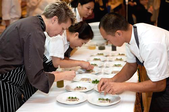 Chefs Elizabeth Faulkner and James Syhabout plate dishes at last year's Tibetan Aid Project gala. (Photo courtesy of the organization)