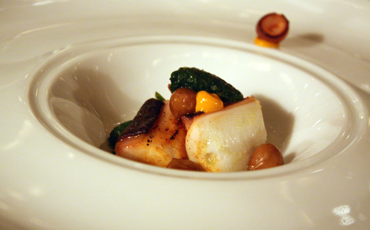 Grilled octopus with hazelnuts with the texture of tender chickpeas.
