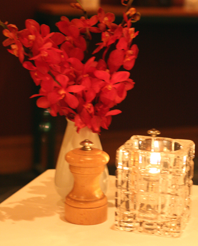 Sprays of flowers grace the tables at the restaurant.