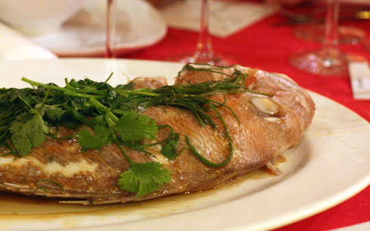 Whole steamed fish.