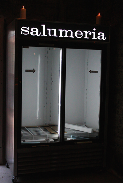 The refrigerator case at the soon-to-open Salumeria a block away.
