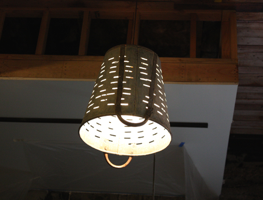 Light fixtures at Salumeria fashioned from olive picking baskets.