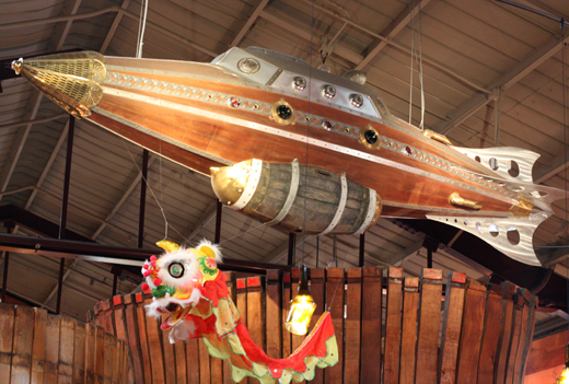 A New Year's dragon vies for space with a spaceship. 