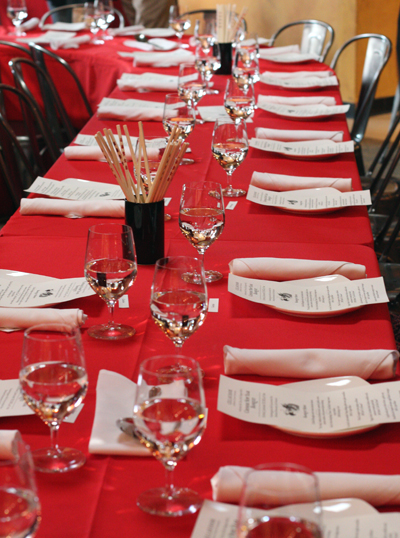 Festive red tablecloths covered long tables that were arranged in a ...