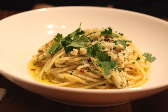 Pasta tossed with crab, parsley, garlic and chili flakes.