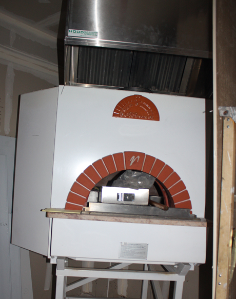 The pizza oven in the restaurant portion of the space that is yet to be finished.