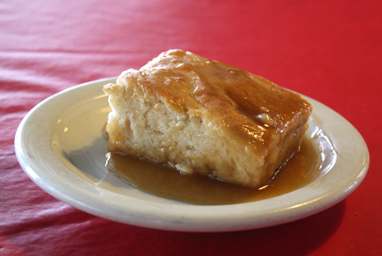 Pouding Chomeur -- white cake soaked in warm maple syrup.