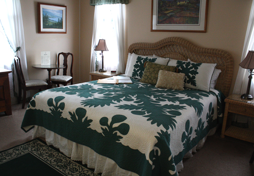 The bedrooms are adorned with handmade Hawaiian quilts.