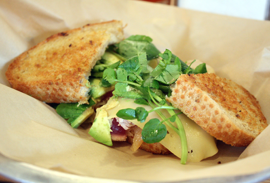 A satisfying ahi sandwich with watercress.