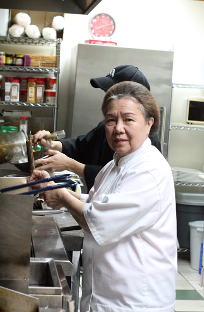 Pat Pongsil at work in her kitchen at Thai Lemongrass.