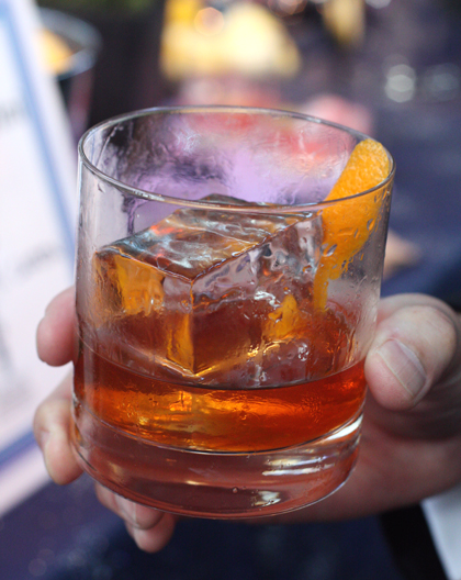 A rye cocktail with a massive ice cube.