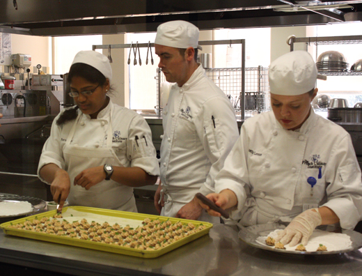 Students preparing food for the reception with Pepin.