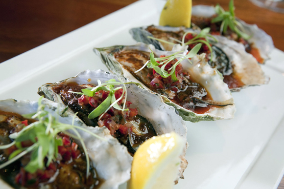Oysters fresh off the grill at Fish Story. (Photo courtesy of the restaurant)