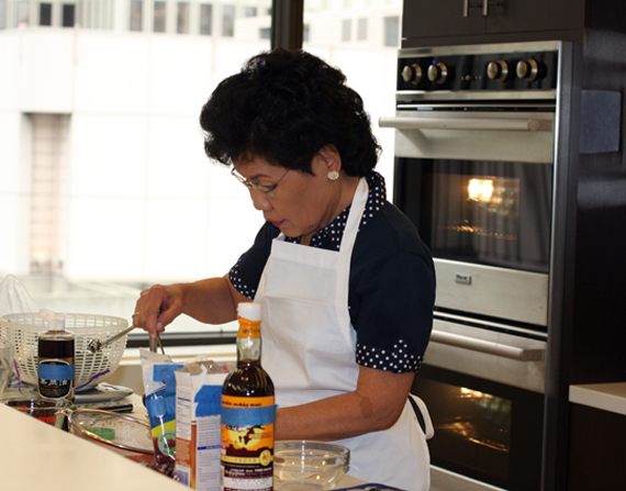 Loanne Chiu preparing her kale salad in the Del Monte test ktichen.