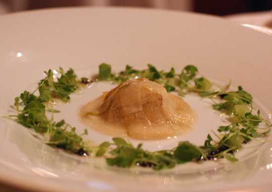 A raviolo of pear and foie gras.
