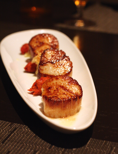 Big diver scallops with a fun garnish of bread pudding.