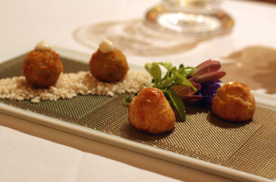 Warm ricotta puffs and two-bite arrancini get the palate going.