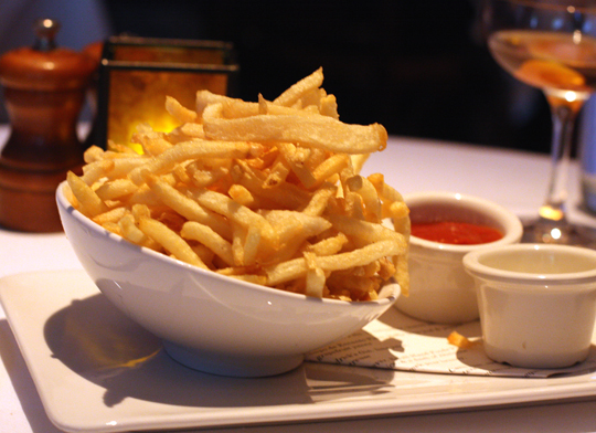 Thin fries with smoky tomato ketchup and aioli. Order them just because.