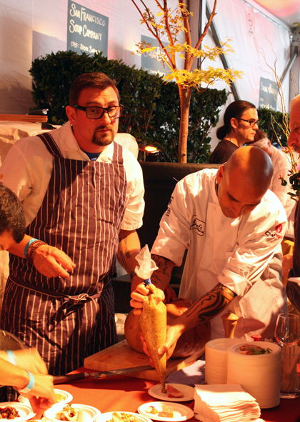 Chris Cosentino, dishing up delectable pork charcuterie iwth help from Chef Mourad Lahlou.